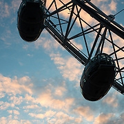 Silhouette of some of the passenger pods on the London Eye against late afternoon clouds and sky. London, United Kingdom.