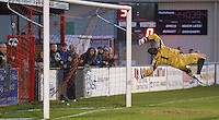 Eastbourne Borough Football Club Ollie Rowe's goal flies into the back of the net, passed Luke McCormick goalkeeper with Truro City FC.