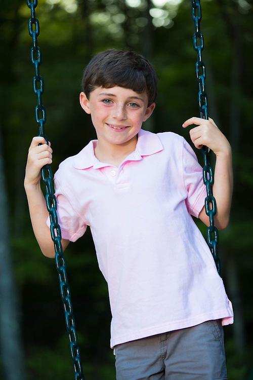 Portrait of boy on swing