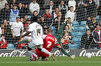Photo: Paul Thomas.<br /> MK Dons v Swindon Town. Coca Cola League 1.<br /> 01/10/2005.<br /> <br /> MK Dons player Malvin Camara puts the ball into the net past Swindon keeper Tom Heaton and defender Sean O'Hanlon.