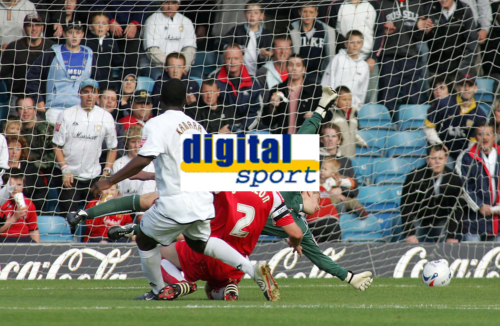 Photo: Paul Thomas.<br /> MK Dons v Swindon Town. Coca Cola League 1.<br /> 01/10/2005.<br /> <br /> MK Dons player Malvin Camara puts the ball into the net past Swindon keeper Tom Heaton and defender Sean O'Hanlon.