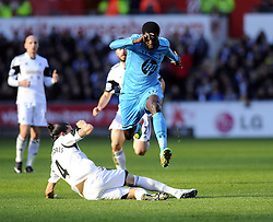 Swansea City's Chico tackles Tottenham Hotspur's Emmanuel Adebayor - Photo mandatory by-line: Joe Meredith/JMP - Tel: Mobile: 07966 386802 19/01/2014 - SPORT - FOOTBALL - Liberty Stadium - Swansea - Swansea City v Tottenham Hotspur - Barclays Premier League