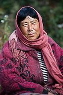 A woman selling souvenirs near the monastery of Taktshang. Paro, Bhutan.