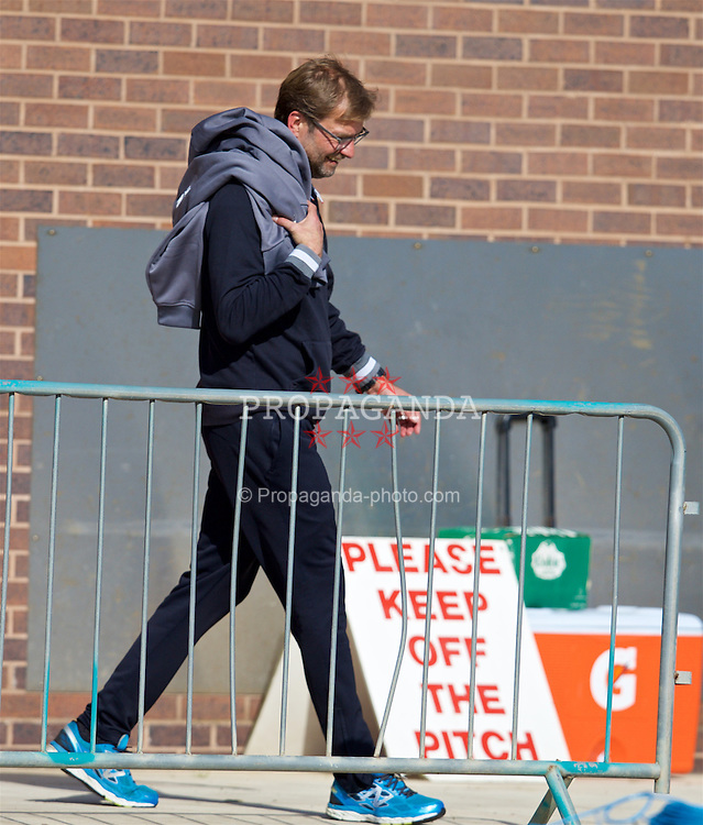 """LIVERPOOL, ENGLAND - Wednesday, May 4, 2016: Liverpool's manager Jürgen Klopp walks out for a training session at Melwood Training Ground past a """"Please Keep Off The Pitch"""" sign ahead of the UEFA Europa League Semi-Final 2nd Leg match against Villarreal CF. (Pic by David Rawcliffe/Propaganda)"""