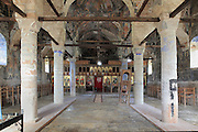 Nave, side aisles and iconostasis of the Dormition of Saint Mary Cathedral Church, or Kisha Katedrale Fjetja e Shen Marise, built 1699, Voskopoje, Korce, Albania. The church contains frescoes by Theodor Anagnost and Sterian from Agrapha in Greece, and the large icons in the iconostasis were painted 1703 by Constantine Lemoronachos. Picture by Manuel Cohen
