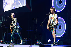 © Licensed to London News Pictures. 24/04/2014. London, UK.   McBusted performing live at The O2 Arena.   *** LICENSE CONDITIONS USAGE ALLOWED ONLY UNTIL 14 MAY 2014, NO USAGE BEYOND THAT DATE***.  In this picture - Tom Fletcher (left), James Bourne (right).  McBusted are an English pop-rock group composed of members of the bands Busted & McFly - James Bourne, Tony Fletcher, Danny Jones, Harry Judd, Dougie Poynter, and Matt Willis.  The only member of the original groups not participating in the new lineup is former Busted singer CharlieSimpson. Photo credit : Richard Isaac/LNP