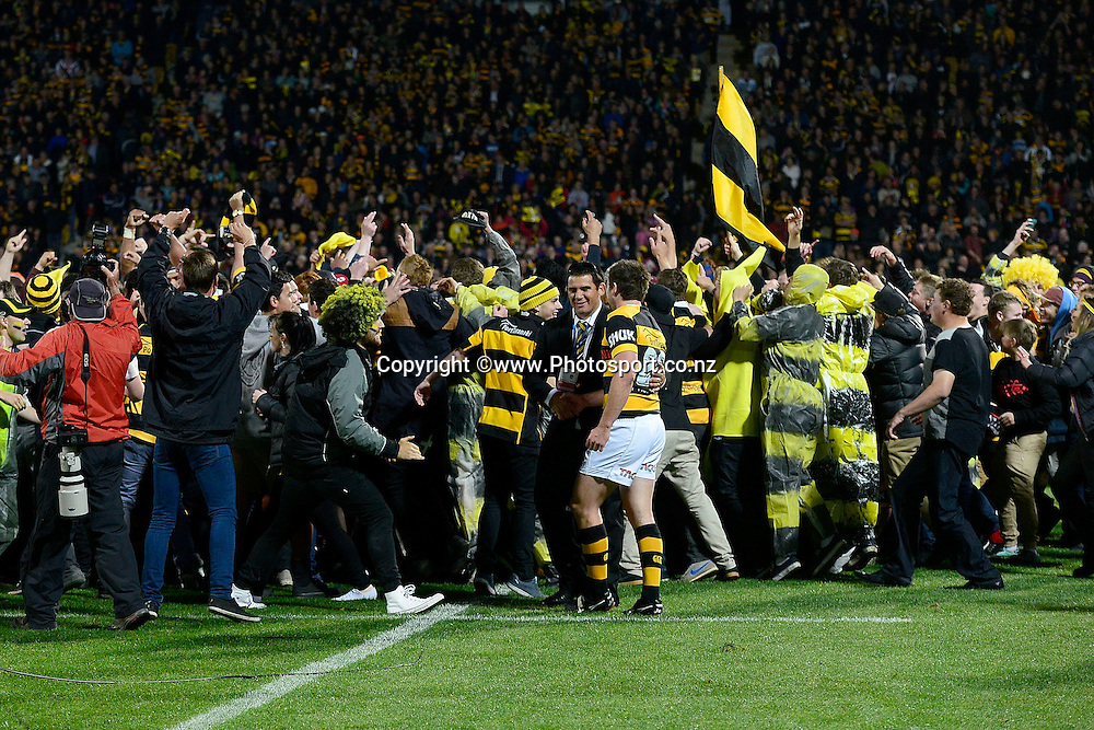 Taranaki fans run onto the field after winning the ITM Cup during the ITM Cup Premiership Final between Taranaki & Tasman at Yarrow Stadium in New Plymouth, New Zealand, 25th October 2014. Photo: Marty Melville/Photosport.co.nz