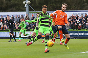 Forest Green Rovers Keanu Marsh-Brown(7) is challenged by Luton Towns Andrew Shinnie during the EFL Sky Bet League 2 match between Forest Green Rovers and Luton Town at the New Lawn, Forest Green, United Kingdom on 16 December 2017. Photo by Shane Healey.