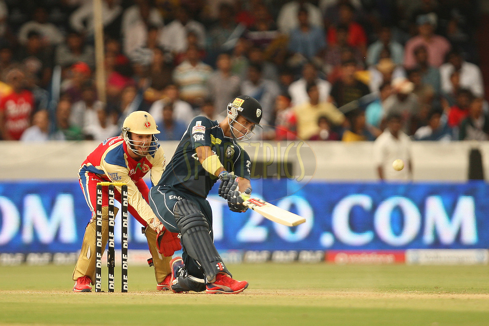 JP Duminy hits the third six in a single over during match 71 of the the Indian Premier League ( IPL) 2012  between The Deccan Chargers and the Royal Challengers Bangalore held at the Rajiv Gandhi Cricket Stadium, Hyderabad on the 20th May 2012..Photo by Jacques Rossouw/IPL/SPORTZPICS