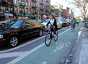 11 March 2013 -  New York, NY. A woman rides her bike in the East Village on March 9, 2013. 03/11/13 - Photograph by Meredith Rosenberg/CUNY Journalism Photo
