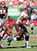 TAMPA, FL - OCTOBER 15:  Wide receiver Michael Clayton #80 of the Tampa Bay Buccaneers gains some key yardage on the winning touchdown drive while avoiding a tackle by cornerback Deltha O'Neal #24 of the Cincinnati Bengals at Raymond James Stadium on October 15, 2006 in Tampa, Florida. The Bucs defeated the Bengals 14-13. (©Paul Anthony Spinelli) *** Local Caption *** Michael Clayton;Deltha O'Neal