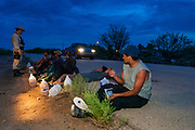 24 APRIL 2003 - SELLS, ARIZONA: Undocumented immigrants in custody of the US Border Patrol wait for pickup by a BP transport van on the Tohono O'Odham reservation south of Sells, AZ. The Tohono O'Odham reservation, which spans much of the southern Arizona border with Mexico, was a major crossing point for undocumented immigrants after urban entry points, like Nogales, AZ, and Douglas, AZ, were shut down.          PHOTO BY JACK KURTZ