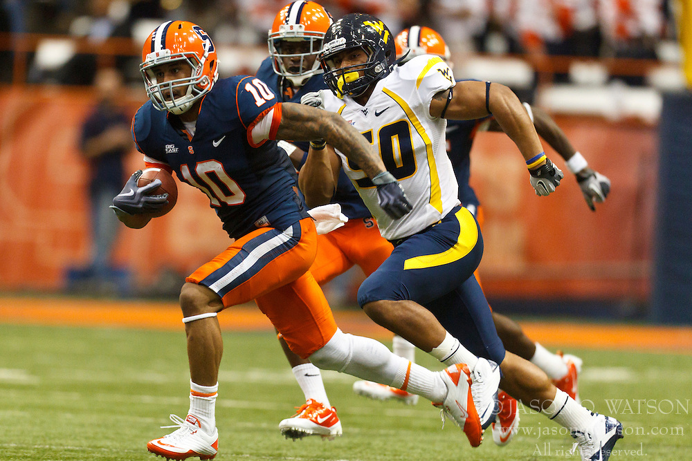 Oct 21, 2011; Syracuse NY, USA;  Syracuse Orange wide receiver Dorian Graham (10) returns a kick off for a touchdown against the West Virginia Mountaineers during the second quarter at the Carrier Dome.  Syracuse defeated West Virginia 49-23. Mandatory Credit: Jason O. Watson-US PRESSWIRE