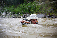 photo Randy Vanderveen, .Grande Prairie, Alberta.Grande Prairie firefighter Chris Storeshaw swims across the Red Willow River during a swift water training class.