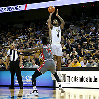 ORLANDO, FL - NOVEMBER 15:  Ceasar DeJesus #4 of the UCF Knights shoots the ball over David Efianayi #11 of the Gardner Webb Runnin Bulldogs during a NCAA basketball game at the CFE Arena on November 15, 2017 in Orlando, Florida. (Photo by Alex Menendez/Getty Images) *** Local Caption *** Ceasar DeJesus; David Efianayi