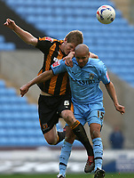 Photo: Pete Lorence.<br />Coventry City v Hull City. Coca Cola Championship. 03/03/2007.<br />Michael Turner and Leon McKenzie battle for the ball.