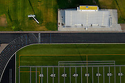 The Frederick High School athletics field is seen from the air on Friday. Frederick in Flight runs Saturday June 25 and 26 and features a hot air balloon lift offs, live music, food vendors, a beer and wine garden, activities for kids and hot air balloons candle-sticking and glowing.<br /> Matthew Jonas/Staff Photographer June 24, 2016