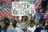 GLENDALE, AZ - SEPTEMBER 25: Dallas Cowboy fans hold a sign stating 'Trump you are the SOB' and 'You're both fired' prior to the NFL game between the Dallas Cowboys and Arizona Cardinals at University of Phoenix Stadium on September 25, 2017 in Glendale, Arizona.  (Photo by Jennifer Stewart/Getty Images)
