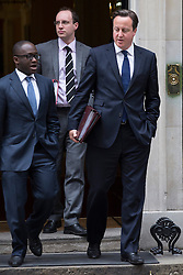 © licensed to London News Pictures. London, UK 26/06/2013. Prime minister David Cameron (right) leaving Downing Street on Wednesday, 26 June 2013. Photo credit: Tolga Akmen/LNP