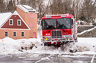 The Katonah Fire Department took delivery of it's new HME built Engine 117 on February 11, 2017. The all wheel drive vehicle makes it's way through the snow sun the training field at KFD headquarters. (photo by Gabe Palacio)