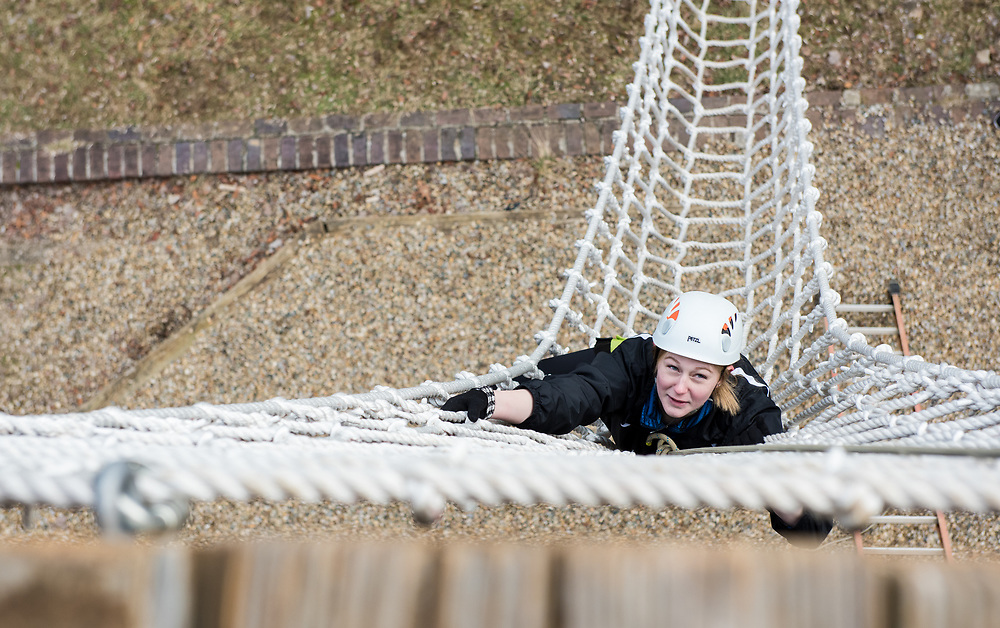 Catherine Balcerek climbs a 40ft rope wall during  the Zip Line facility Sibs Weekend event at The Ridges on Feb. 3rd, 2018.