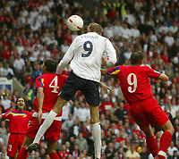 Photo: Aidan Ellis.<br /> England v Andorra. European Championships 2008 Qualifying. 02/09/2006.<br /> England's Peter Crouch  scores the fifth goal