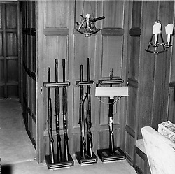 Interior shots of Aristotle Onassis's yacht Christina photographed in 1956.<br /> Picture shows The corner of Mr Onassis' study were his guns are stored including a harpoon rifle for big game fishing.<br /> <br /> <br /> NON EXCLUSIVE - WORLD RIGHTS