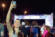 A runner takes a selfie at start line of the Red Bull Wings For Life World Run in Denver, CO, USA on 4 May, 2014. ©Brett Wilhelm