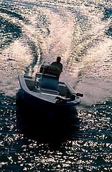 Speedboat running through Galveston Bay at sunset