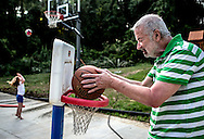 Tom and his granddaughter, Reese, simultaneously go for a basket in their backyard. The difference is while Reese is young she is learning and building the muscle to throw the ball higher, while her Grandpa Tom no longer has the strength to toss the ball. Tom was diagnosed with Alzheimer's eight years ago and just moved in with his son Morgan, daughter-in-law, Abby and their two children.