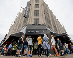 © Licensed to London News Pictures. 10/08/2018. London, UK. Shoppers queue outside House of Fraser's flagship store on Oxford Street in London. The department store chain has reportedly been bought by Sports Direct for £90m after administrators were appointed. Photo credit: Rob Pinney/LNP