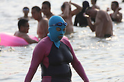 QINGDAO, CHINA - AUGUST 14: (CHINA OUT) <br /> <br /> Women wearing Facekini<br /> <br /> Women wearing Facekini enjoy themselves at a beach on August 14, 2014 in Qingdao, Shandong Province of China. The mask is used by people for protecting themselves from the sun's rays, jellyfish and algae.<br /> ©Exclusivepix