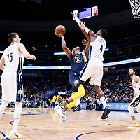 03 April 2018: Indiana Pacers center Myles Turner (33) goes for the layup against Denver Nuggets forward Paul Millsap (4) during the Denver Nuggets 107-104 victory over the Indiana Pacers, at the Pepsi Center, Denver, Colorado, USA.