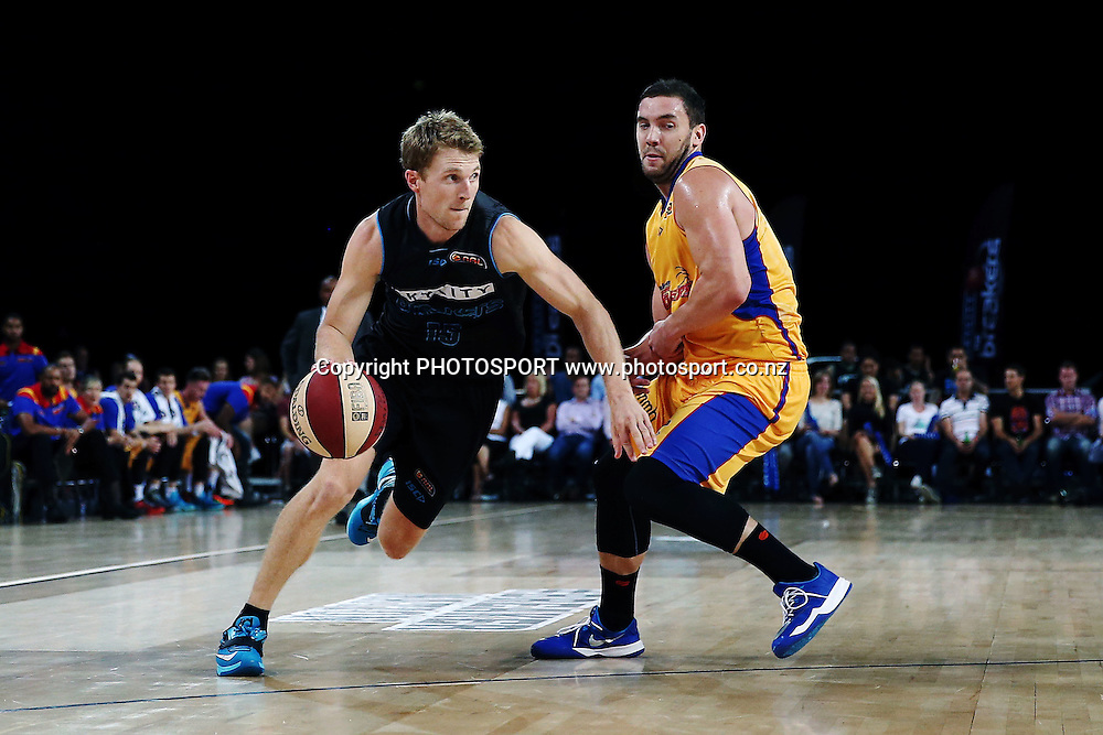 Rhys Carter of the Breakers drives past Adam Gibson of the 36ers. 2014/15 ANBL, SkyCity Breakers vs Adelaide 36ers, Vector Arena, Auckland, New Zealand. Thursday 12 February 2015. Photo: Anthony Au-Yeung / www.photosport.co.nz