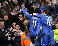 Drogba celebrates his goal with Robben of Chelsea