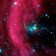 NASA's Spitzer Space Telescope took this image of a baby star sprouting two identical jets.
