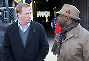 "NFL Commissioner Roger Goodell talks to Executive Director of the National Football League Players Association (NFLPA) DeMaurice ""De"" Smith before the Baltimore Ravens AFC Wild Card Playoff football game against the Indianapolis Colts on Sunday, Jan. 6, 2013 in Baltimore. The Ravens won the game 24-9. ©Paul Anthony Spinelli"