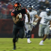 18 November 2017:  The San Diego State football team hosts Nevada Saturday night. San Diego State Aztecs running back Rashaad Penny (20) breaks a tackle for a touchdown run in the fourth quarter. The Aztecs beat the Wolf Pack 42-23 at SDCCU stadium. <br /> www.sdsuaztecphotos.com
