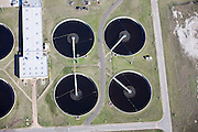 Wastewater treatment plant with sedimentation tanks.