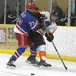 COCHRANE, ON - MAY 4: Spenser Kersten #77 of the Oakville Blades makes the hit on Cameron Clark #6 of the Hearst Lumberjacks  during the second period on May 4, 2019 at Tim Horton Events Centre in Cochrane, Ontario, Canada.<br /> (Photo by Tim Bates / OJHL Images)