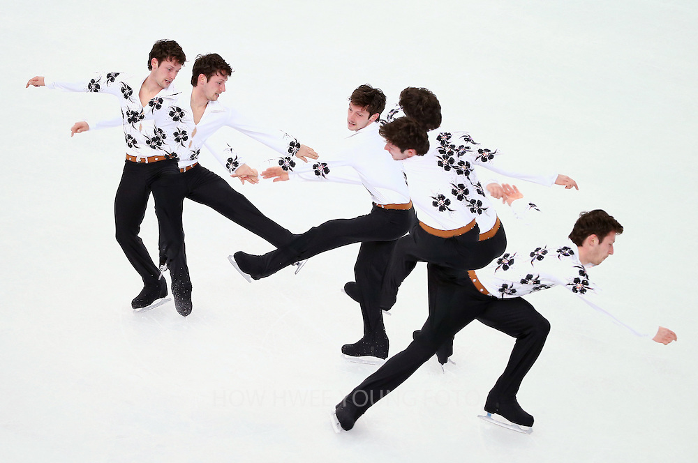 A multiple exposure image shows Zoltan Kelemen of Romania performing during the Men's Short Program of the Figure Skating event at the Iceberg Palace during the Sochi 2014 Olympic Games, Sochi, Russia, 13 February 2014