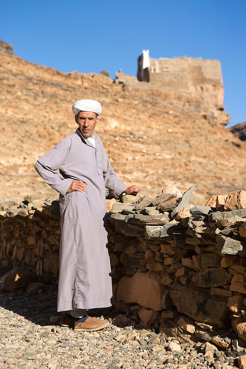 AMTOUDI, MOROCCO - JUNE 2ND 2016 - Key Keeper Abdullah stands infront of the Amtoudi Granary (Agadir Id Aissa), Guelmim province of Southern Morocco.