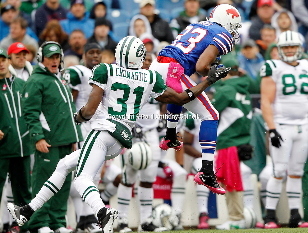 Buffalo Bills wide receiver Lee Evans (83) leaps to catch an incomplete pass while covered by New York Jets cornerback Antonio Cromartie (31) during a NFL week 4 football game against the New York Jets on Sunday, October 3, 2010 in Orchard Park, New York. The Jets won the game 38-14. (©Paul Anthony Spinelli)