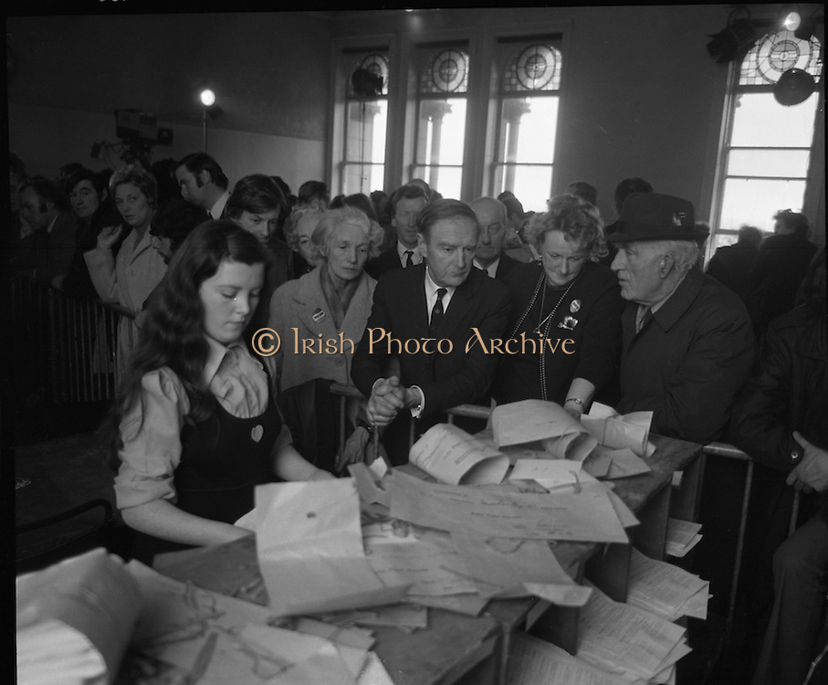Mr Liam Cosgrave,Leader of Fine Gael,at Vote Count. (E48).1973..01.03.1971..03.01.1973..1st March 1973..As the ballot boxes were opened in Dun Laoghaire Town Hall, Mr Cosgrave and his supporters watched as the voting papers were piled high. The vote was as the result of an often hectic General Election campaign. Mr Cosgrave was hoping his party would garner enough votes to oust the sitting Fianna Fail Government which had held power for sixteen years...Image Of Mr Cosgrave as he anxiously watches the ballots being organised for counting.