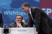 17 NOV 2003, BOCHUM/GERMANY:<br /> Gerhard Schroeder (L), SPD, Bundeskanzler, und Klaus Wowereit (R), SPD, Reg. Buergermeister Berlin, im Gespraech, SPD Bundesparteitag, Ruhr-Congress-Zentrum<br /> IMAGE: 20031117-01-002<br /> KEYWORDS: Parteitag, party congress, SPD-Bundesparteitag