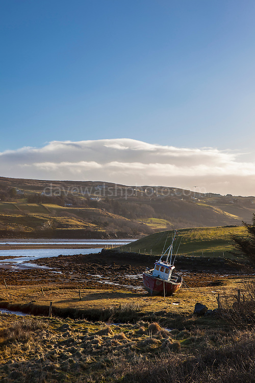 Beached fishing boat in Teelin Bay, near Carrick, Donegal, Ireland