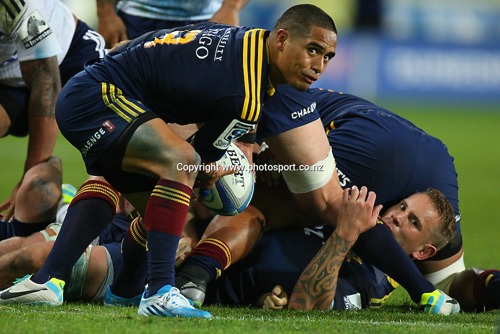 Highlanders Aaron Smith looks to get the ball away against the Blues in the Super Rugby match, Forsyth Barr Stadium, Dunedin, New Zealand, Saturday, February 22, 2014. Photo: Dianne Manson / photosport.co.nz