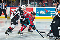 KELOWNA, CANADA - MARCH 16:  Yannik Valenti #20 of the Vancouver Giants back checks Michael Farren #16 of the Kelowna Rockets on March 16, 2019 at Prospera Place in Kelowna, British Columbia, Canada.  (Photo by Marissa Baecker/Shoot the Breeze)