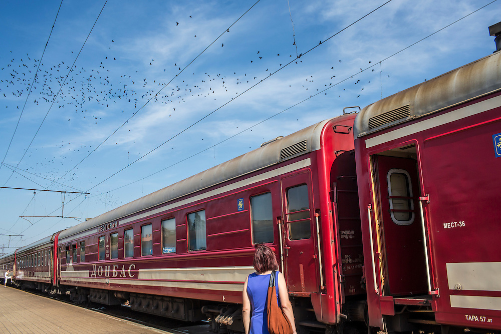A woman watches a relative aboard a train traveling from Donetsk to Moscow, away from areas with heavy fighting, on Monday, July 28, 2014 in Yasinovataya, Ukraine.