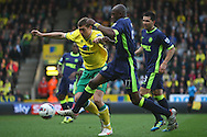 Picture by Paul Chesterton/Focus Images Ltd.  07904 640267.11/03/12.Grant Holt of Norwich and Emmerson Boyce of Wigan in action during the Barclays Premier League match at Carrow Road Stadium, Norwich.